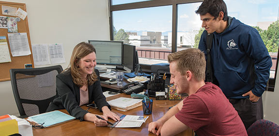 Adviser assisting CSU-Pueblo students