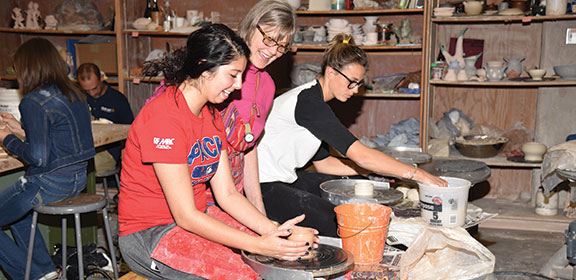Colorado State University-Pueblo student working on pottery