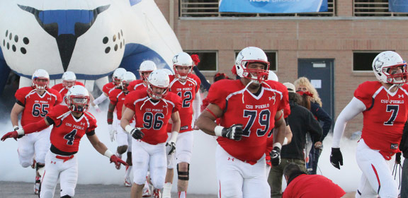 Colorado State University-Pueblo football players coming out of the locker room