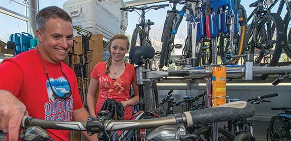 Colorado State University-Pueblo Outdoor Pursuits staff preparing bikes to rent