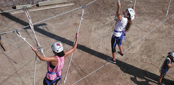 Students crossing the Multi-vine Traverse on the Challenge Course