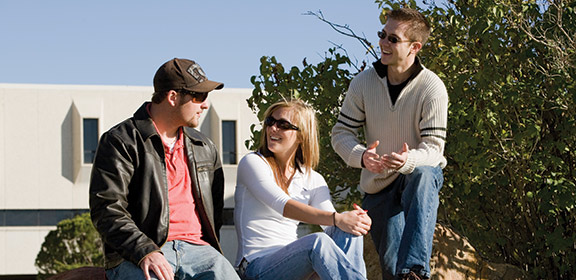 Students conversing with each other on campus