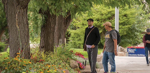 Colorado State University-Pueblo student walking with faculty member