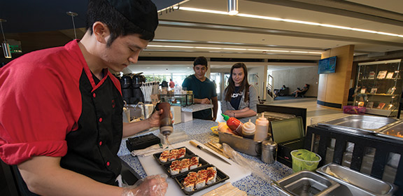 Sushi being prepared at the Cafe Libro in the Library and Academic Resource Center