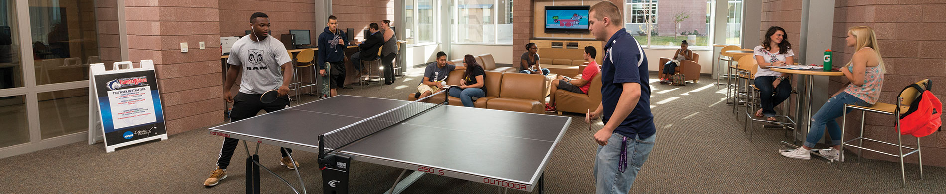 Students playing ping pong in the Culebra Lobby