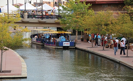 People walking on the Pueblo Riverwalk