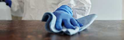Hand with glove cleaning surface