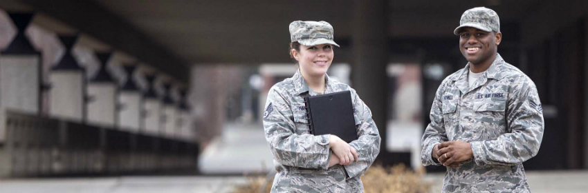 airman at a range smiling