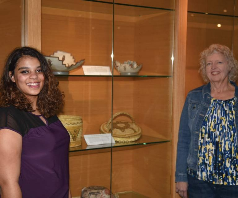 Bryana Owens and Bev Allen in front of Archives