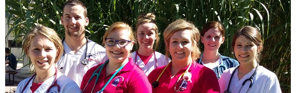 Seven nursing students smiling at camera